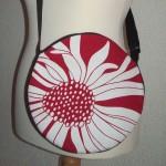 Blumige kreis-runde Tasche
