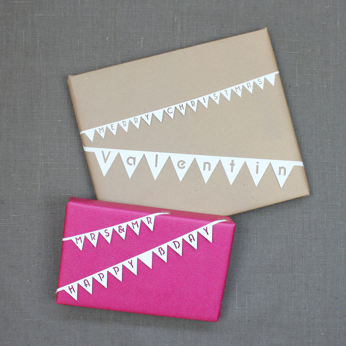 Individuelle Wimpelketten als Geschenkbänder - erstellt mit der Schriftart KUGELIG Garland