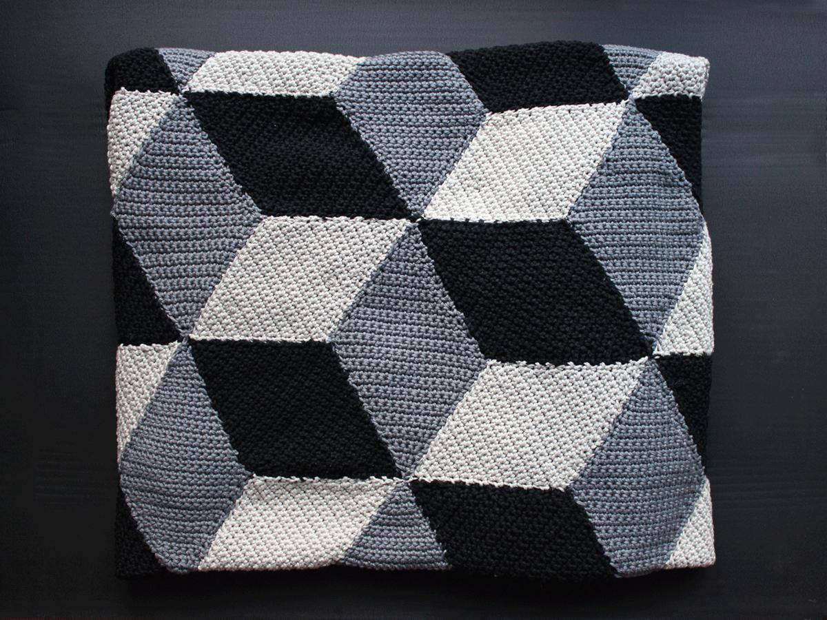 Geometrische Häkeldecke mit 3D-Muster